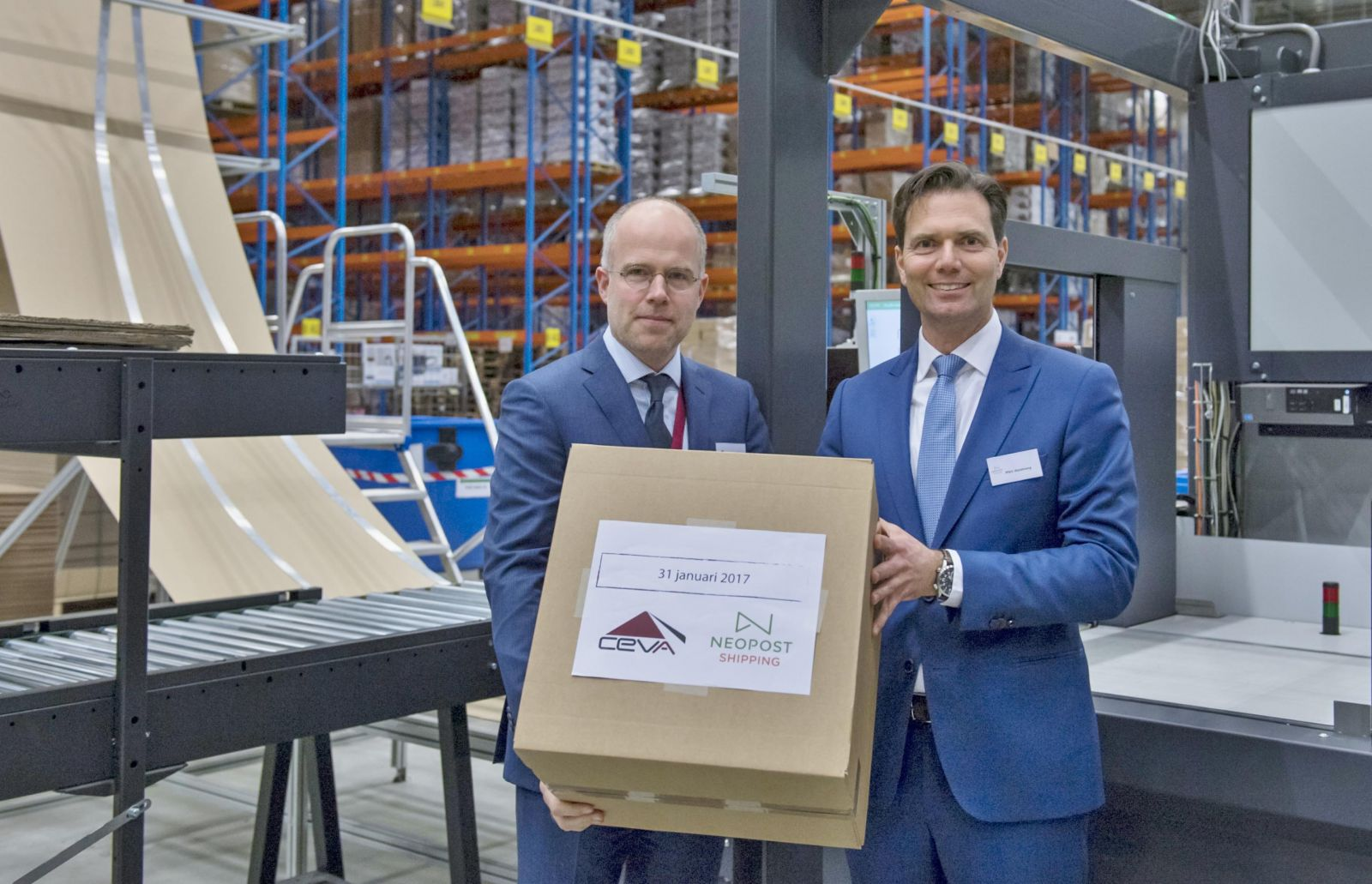 First box ceremony with Willem Veekens, Vice President Contract Logistics Benelux CEVA Logistics and Marc Aandeweg, Head of Global Sales & Operations Quadient Shipping